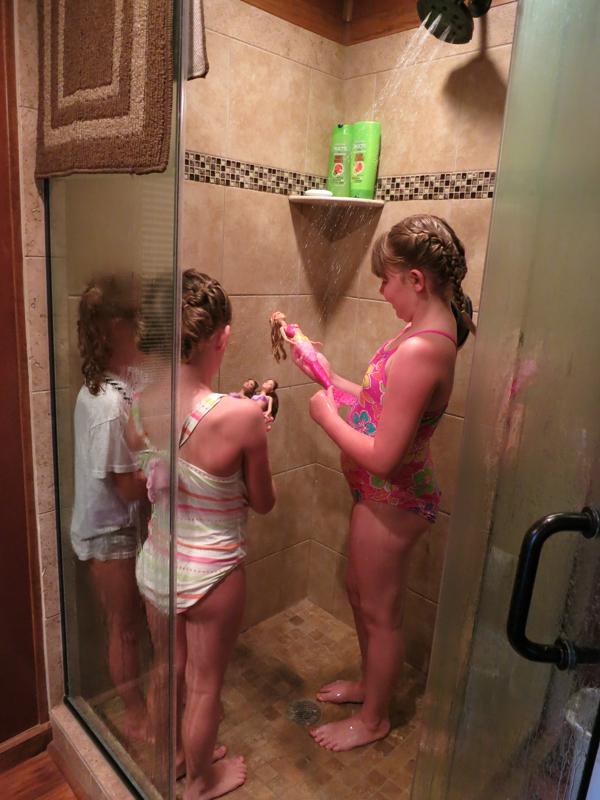 School showers teen girls apologise